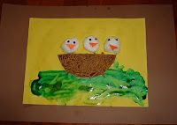 "fingerpainted green leaves on yellow paper, which we glued onto a brown background. Then he glued white cotton balls for chicks with googly eyes and orange paper beaks. We then used FiberOne cereal glued to a brown paper ""nest""."
