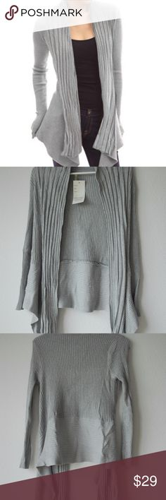 Brand new India Boutique grey metallic Cardigan This is a cute grey cardigan with silver threads in it which gives it a gallant look. Longer in the front. Brand new with tags. Free size. Fits me and I'm an M. 100% Polyester. From a smoke and pet free home. India Boutique Sweaters Cardigans