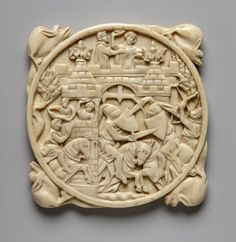 14th cent. France. Mirror-case; ivory; carved; circular; depicts Assault on the Castle of Love; knights attack fortified gateway, women at top throw flowers; four dragons project from rim.