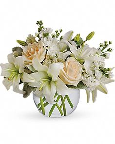 Isle of White Roses Bouquet at Send Flowers. Elegant white flower bouquet with cream roses, white asiatic lilies and white stock flowers in a bubble vase. Winter Flowers, Fresh Flowers, Beautiful Flowers, Winter Bouquet, Send Flowers, Big Flowers, Exotic Flowers, Wreaths For Funerals, Arreglos Ikebana