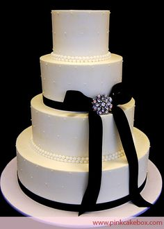 4-Tier Buttercream Wedding Cake. So simple and elegant.