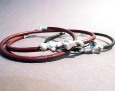 Abstracción; 2015 Pulseras de Plata y Cuero (leather and silver bracelets) Cristina Alises