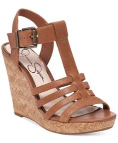 """Jessica Simpson Jenaa Wedge Sandals: Vintage-inspired t-strap and platform wedge styling bring retro appeal to your office-to-weekend look in these sandals from Jessica Simpson. Fabric content and colors include. Leather in burnt umber. Manmade in powder or black. Round open-toe t-strap platform wedge sandals. 3/4"""" platform, 4"""" wedge heel. Leather or manmade uppers, manmade sole. 5.5 $79.00"""