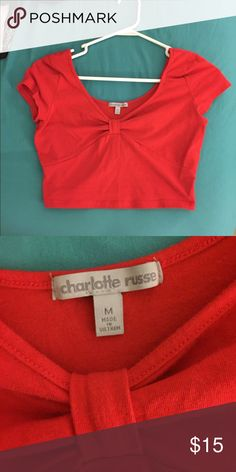 Red scoop neck crop top Red crop top with bow like front. Only worn once because it wasn't the right size. Charlotte Russe Tops Crop Tops