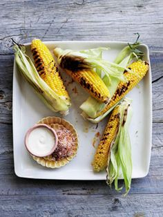 Barbecued corn with chipotle salt and sour cream.