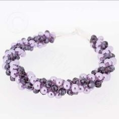Kumihimo Bracelet - Light Purple  You must have a go at these bracelets, they are so easy to make and very pretty. They come with full instructions for you to use. I am sure all your friends will be asking you to make one, but don't tell them it only cost £4.99.