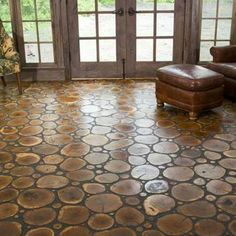 Flooring idea/ circle tree cuts . . .  Those tree cuts all tell a story and add such a fun pattern to the room.  #aweinspiring #dreamhome