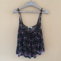 UO floral tank Adorable black with pink floral pattern. Size small! in good condition, pre loved. Very cute for any season!! Urban Outfitters Tops Tank Tops