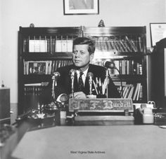 1960 Presidential Campaign in West Virginia Photograph, Senator John F. Kennedy at Secretary of State Joe Burdette's desk filing to run in the presidential primary, February 6, 1960, Charleston. Photograph by Emil Varney. Emil Varney Collectio ♡♡♡♡♡♡♡♡  http://www.jfklibrary.org/JFK/JFK-in-History/Campaign-of-1960.aspx