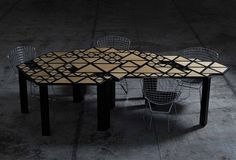 The table is a geometric interpretation of the dynamics of movement found in nature and will be constructed from all natural and sustainable materials including mostly wood.