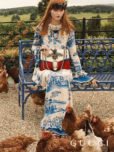 Collecting eggs at Chatsworth in the Gucci Cruise17 campaign, featuring a printed silk crêpe de Chine gown, with sequin web details, ruffles and pearl buttons and the Gucci Dionysus bag embroidered with a bee.