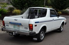 1979 Subaru BRAT...my first car. (Mine was blue, with a roll bar, lights and tonneau cover.)