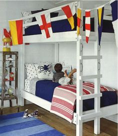 "Vintage nautical flags found at a yard sale add supercharged color to this boys' bunk room in Amagansett, Long Island. The free-standing bunks and red, white, and blue color scheme perfectly suit the family, which designer Jarlath Mellett describes as ""ch Nautical Flags, Nautical Home, Vintage Nautical, Kids Bedroom, Bedroom Decor, Kids Rooms, Bedroom Ideas, Bedroom Beach, Boy Bedrooms"
