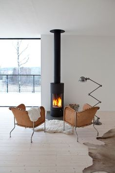Fireplace. Winter Inspiration. White wood floor.: