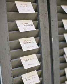 Escort cards were placed in shutters, which the bride picked up at an antiques store. Wedding Reception Seating, Seating Chart Wedding, Wedding Table Numbers, Wedding Vows, Diy Wedding, Wedding Ideas, Reception Ideas, Budget Wedding, Wedding Bells