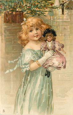 Girl in green dress holds doll