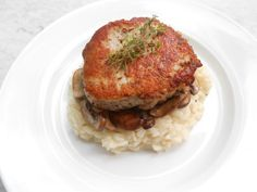 pork chops with black truffle butter risotto, and mushrooms.
