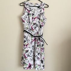 White House Black Market floral dress sz 10 White House Black Market Summer Iris orchid floral dress in a size 10. Dress is sleeveless with black belt, side pockets, zip up back and has a symmetrical shape.  It is just beautiful!! White House Black Market Dresses Midi