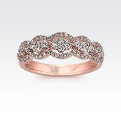 This distinguishing and fashionable ring is embellished by 76 round diamonds at approximately .54 carat total weight. While the five sectioned appearance is delicately decorated by outlining diamonds, the center is also accented by additional blooming diamonds. The ring is crafted of quality 14 karat rose gold and displays an elegant pav