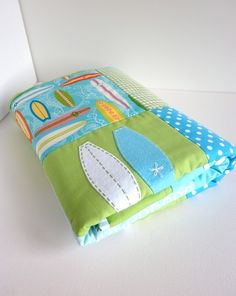 Cute!!  Fab colors...love the surf boards!    SURFBOARD Baby Boy Quilt in blue and green-ready to ship. $160.00, via Etsy.