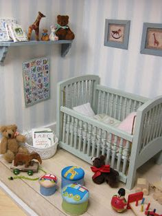 Dollhouse-sized crib and nursery accesories (image only) | Source: miniatyrmama