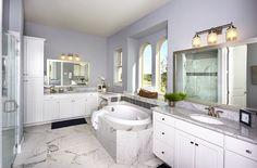 Gehan Homes Master Bathroom - Lavender walls, gray tile, granite countertops, white wood cabinets, drop in spa bath, arched windows. San Antonio, Texas   Afton Oaks - Monarch #Gehanhomes