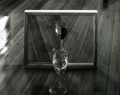 Mirror, Glass, Water and Wine- Abelardo Morell This photographer played with leading lines in his photo. They are uniform until there is a contrasting interruption. This caused the viewer's eye to be drawn to the focal point of the wine glasses. Contemporary Photography, Artistic Photography, Contemporary Art, Best Black, Black And White, Lead Lines, Master Of Fine Arts, Water Into Wine, Artists And Models