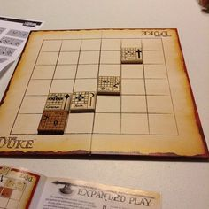 The Duke is a dynamic, tile-based strategy game with an old-world, feudal theme, high-quality wooden playing pieces, and an innovative game mechanism in its double-sided tiles. Each side represents a different posture – often considered to be defensive or offensive – and demonstrates exactly what the piece can do within the turn. At the end of a move (or after the use of a special ability), the tile is flipped to its other side, displaying a new offensive or defensive posture.  Each posture…