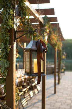 lanterns tied off with satin ribbon | Heather Roth #wedding