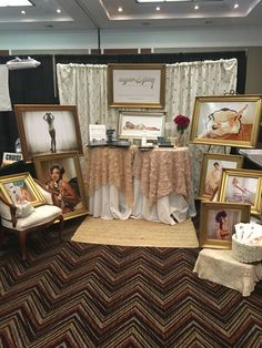 Such a great booth setup from Sugar and Spice Boudoir Photography. Display of custom framed photos and albums with a custom home feel to welcome new brides. Www.sugarandspiceboudoir.com #boothdisplay #sugarandspiceboudoir #boudoirphotograohy