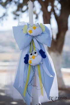 Christening Candle with two fabric owls.