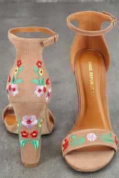 Be unstoppable in the Suri Taupe Embroidered Ankle Strap Heels! These stunning heels have a vegan suede peep-toe upper, and matching heel cup with adjustable ankle strap (and gold buckle). Red, green, pink, and yellow floral embroidery completes this bold Ankle Strap Heels, Ankle Straps, Quinceanera Shoes, Mexican Quinceanera Dresses, Stiletto Heels, High Heels, Unique Heels, Shoe Boots, Shoes Heels