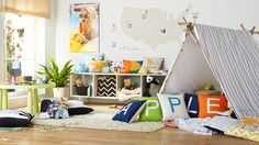 This whimsical playroom is a great place to spell out fun words using Shutterfly pillows. Turn photo cubes into counting blocks and make it easy and exciting for the kids to learn. | www.Shutterfly.com