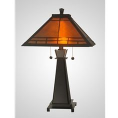 """Dale Tiffany TT10747 Mica Craftsman Table Lamp. On Sale: $219. Rugged steel construction with a Dark Antique Bronze finish. The shade is genuine Amber Mica with a C1909 Mission Geometric Overlay. Very authentic design. 24.5"""" tall, 16"""" square shade, 2 x 60-watts, but use 2 x 26-watt compact fluorescents for 200-watts of brightness while you save money and energy."""