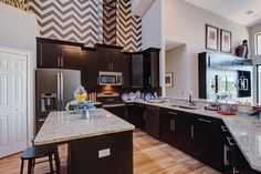 Open kitchen with island seating and modern #chevron wallpaper :: M/I Homes of Tampa: Terra Largo - Corsica Vi Bonus Hlm Model