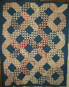 1850-1890s Ocean Wave by the grandmother of by Irma Remple Wilks (born in Gotebo, OK of Jake and Inie Remple in 1909 She died at age 96 in 2005). Mother of home designer/artist Norman Wilkes. Museum quality double crosshatch and outline quilting @ 10-11 st/in. Fabulous navy and brown calicos. Fugitive brown dye has stained  the light shirting prints by being folded against them.  Otherwise Excellent Condition. 60x73 $495 Donation