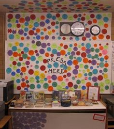 Why not create our own dot book display in the library? -- Press Here by Herve Tullet -- dots track books read