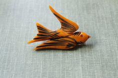 Lovely little vintage carved swallow Bakelite brooch. #vintage #brooches #jewelry #birds #Bakelite