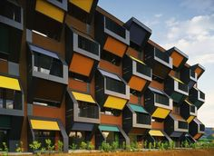 Facade Treatment Built by OFIS arhitekti in Izola, Slovenia with date Images by Tomaz Gregoric. The project is a winning entry for two housing blocks in a competition convoked by the Slovenia Housing Fund, a gover. Architecture Cool, Contemporary Architecture, Residential Architecture, Module Design, Solar Shades, Sun Shades, Social Housing, Property Development, Honeycomb
