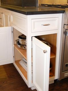 Small Space Gourmet Kitchen : Kitchen Remodeling : HGTV Remodels.   Like this double access with extra cabinet door.