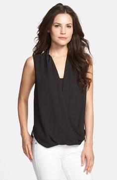 Free shipping and returns on Vince Camuto Faux Wrap Shirttail Blouse (Regular & Petite) at Nordstrom.com. Draped front panels create graceful dimension on a flowing sleeveless blouse styled with a surplice neckline and a long, straight back hem. A front inset provides perfect coverage.