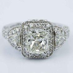 A beautiful Three Stone Halo Milgrain Split Shank Radiant Engagement Ring in White Gold!