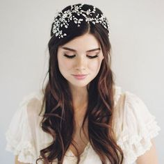 Need something to brighten up your Monday? Our new 2016 boho twist on the tiara is beyond cosmic. Call it sparks, call it fireworks, call it a starburst--but this Swarovski Bridal Hair Accessory is just waiting to grace you down the aisle. Say yes to our most stunning aisle style bridal accessory yet (style 1604)! Only at www.veiledbeauty.com.  @kurtboomerphoto @beautybymelina @lanacarine @shopgossamer @cristincolorist @bespokebeautyla