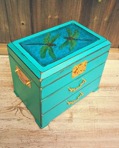 dragonfly jewellery box , vintage jewellery box, dragonflies jewellery box, jewellery armoire, teal green jewellery box, upcycled box Dimensions: 27 x 18 x 24 ( h ) cm.  This lovely wooden jewellery box has been revitalized by painting with chalk paint , then gently distressed and waxed for a velvet finish. The lid has been hand-painted with acrylic paints, decoupaged and finished with crackle acrylic medium to obtain a water effect, then varnished. Lined with creamy white velvet in good…