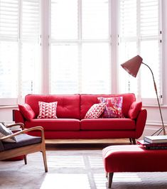 Mid 20th-century designs are still popular. Zinc's bright red sofa – handmade in the UK – Part of our exclusive French Connection range