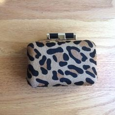 C Wonder Leopard Clutch C Wonder faux leopard printed fur clutch with gold slogan strap and gold lining. Smoke free home. C Wonder Bags Clutches & Wristlets