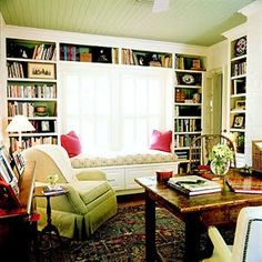 love this window seat with the bookshelves around it