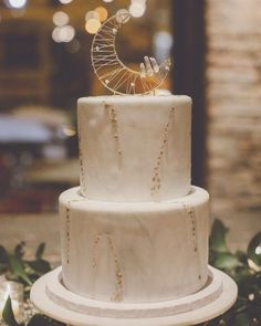 This moon-shaped cake topper crafted from metallic wire and clear quartz is a delicious finishing touch to a celestial wedding. This moon-shaped cake topper crafted from metallic wire and clear quartz is a delicious finishing touch to a celestial wedding. Starry Night Wedding, Moon Wedding, Celestial Wedding, Star Wedding, Wedding Vows, Dream Wedding, Wedding Day, 1920s Wedding, Crystal Wedding