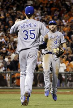 Kansas City Royals' Mike Moustakas and Eric Hosmer (35) celebrate after Game 3 of baseball's World Series against the San Francisco Giants Friday, Oct. 24, 2014, in San Francisco. The Royals won 3-2 to take a 2-1 lead in the series. (AP Photo/David J. Phillip)