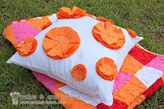 So cute for a little girl's room!  fabric flowers on a pillow- also a great site with many other pillow tutorials